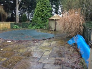 Before, inside pool area with thatched gazebo