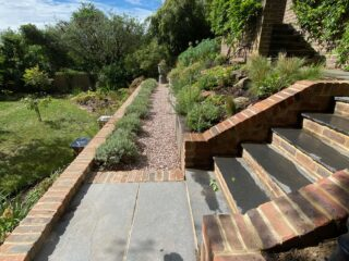 Mid level terrace with gravel path and lavender hedge